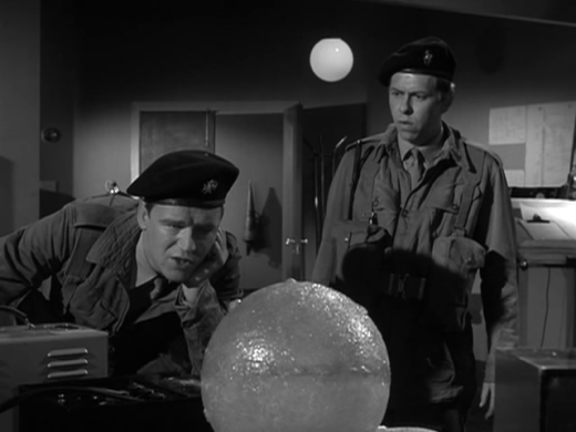 night-caller-7-privates-higgins-waker-l-and-jones-gregory-examine-the-sphere